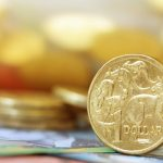 Aussie dips against dollar amid speculation Fed stimulus will close later this year